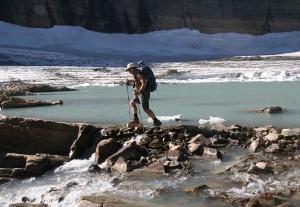 In Glacier National Park, U.S. Geological Survey researcher Dan Fagre treks toward the melting margin of iconic Grinnell Glacier.